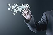 Business man pointing to social media network icons structure