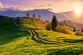mountainous rural landscape in evening light