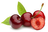 Ripe red cherries with green leaves isolated