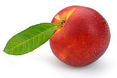 Nectarine peach with leaf on white background