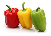 Yellow, red and green bell peppers isolated
