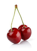 Ripe red cherries with stalks isolated on white