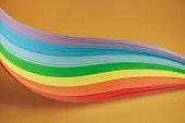 Beautiful rainbow color ribbon on orange background.