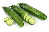 Fresh cucumber with slices isolated on white