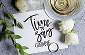 Time to say goodbye. The inscription on a white paper sheet. White wine in a glass glass. Gold engagement ring. Concept - deterioration of relations between people