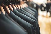 Men's suit displayed on a hanger