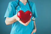 Medicine doctor holding red heart shape in hand, medical concept