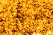 Bokeh of golden glow in christmas event