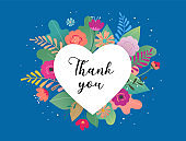 Thank you card. Big white heart with colorful flowers in background