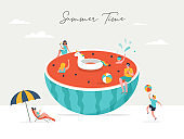 Summer scene, group of people, family and friends having fun against the huge watermellon, surfung, swimming in the pool, drinking cold beverage, playing on the beach