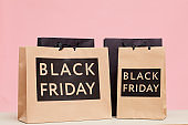 Close-up of Black Friday paperbags on table in shopping store