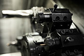 Macro image of lathe cutting tools used for processing different details at factory, focus on drill