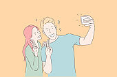 Making selfie, smiling couple, victory gesture concept