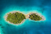 Aerial view on islands on sea. Azure water and islands with trees. Seascape from air at the summer time. Travel - image