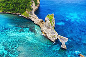 Aerial view at sea and rocks. Turquoise water background from top view. Summer seascape from air. Summer adventure. Travel - image