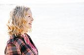 Active seniors enjoying the walk on the beach of California