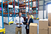 Staffs working together in warehouse
