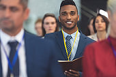 Young businessman looking at camera in a business seminar
