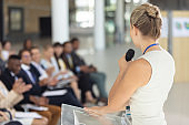 Caucasian businesswoman doing a speech in conference room