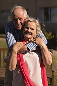 Senior couple embracing each other in the park