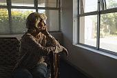Senior woman relaxing in living room at nursing home