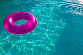Inflatable tube floating in a swimming pool in backyard