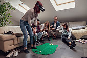group of young adults have fun playing golf