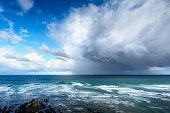 stormy clouds and heavy rain on a sea
