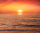 beautiful red sunset on idyllic beach
