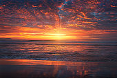 beautiful red sunset on beach with dramatic vivid sky