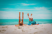 little boy and girl relax on tropical beach