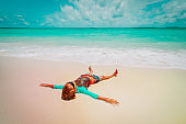 little boy relax on tropical beach vacation