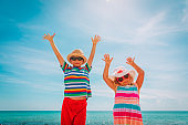 happy kids have fun on beach, little boy and girl enjoy vacation