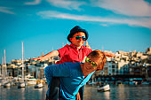 family travel - father and son playing on the quay of Malta