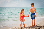 sun protection- little boy and girl with suncream at beach