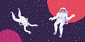 Astronauts man and woman fly in zero gravity in outer space.