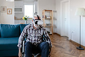 Disabled Senior Man in Wheelchair using Virtual Reality Eyeglasses