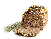 Homemade wholemeal rye bread with chia seed and millet groats isolated on white