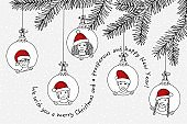 Hand drawn children's faces with santa hats as Xmas decoration