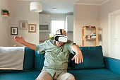 Senior Man Experiencing Virtual Reality Eyeglasses