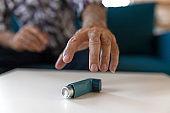 Man Suffering Asthma Attack Reaching Inhaler