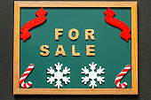Set of FOR SALE of cork ,red ribbon, Candy Kane of the red white and two white snowy crystals isolated on green blackboard and black color background.