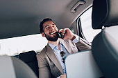 Businessman Working on the Backseat of the Car