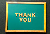 Set of THANK YOU of cork isolated on green blackboard and black color background and copy space.