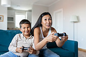 Mother and Son Playing Game Console