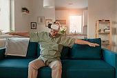 Cheerful Senior Man Experiencing Virtual Reality Eyeglasses Headset