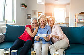 Group of happy elderly people looking at photos