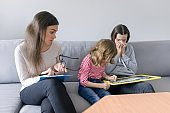 Child professional psychologist working with family