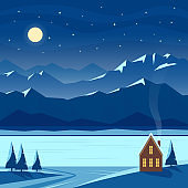Winter moon night with mountain scenery and cozy house.