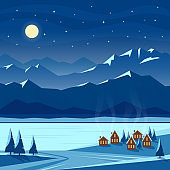 Winter moon night with mountain scenery and cozy houses.